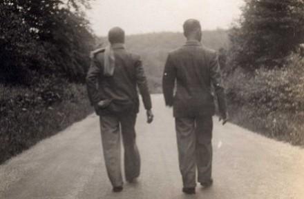 2 men walking b&w