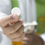 Priest Holding Communion Wafer
