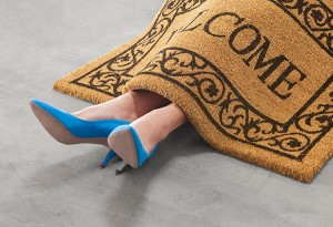 Person under doormat