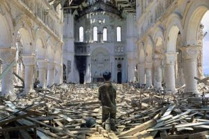 A man praying in a ruined Catholic church in La Vang, a town south of Quang Tri City, Vietnam on July 6, 1972.
